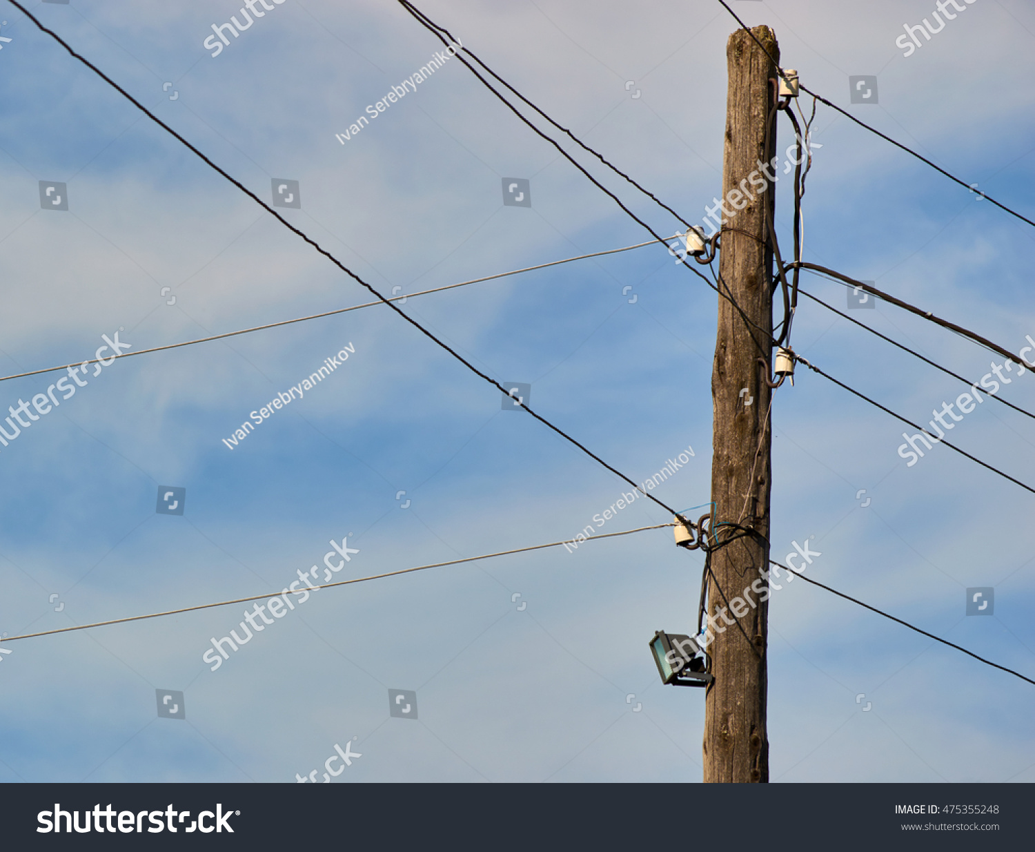 hight resolution of old pole with lamp and wires sky and clouds