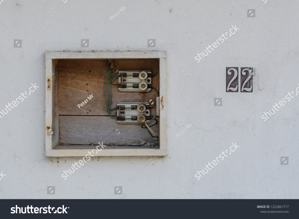 medium resolution of old uncovered wooden fuse box with a house number in mexico