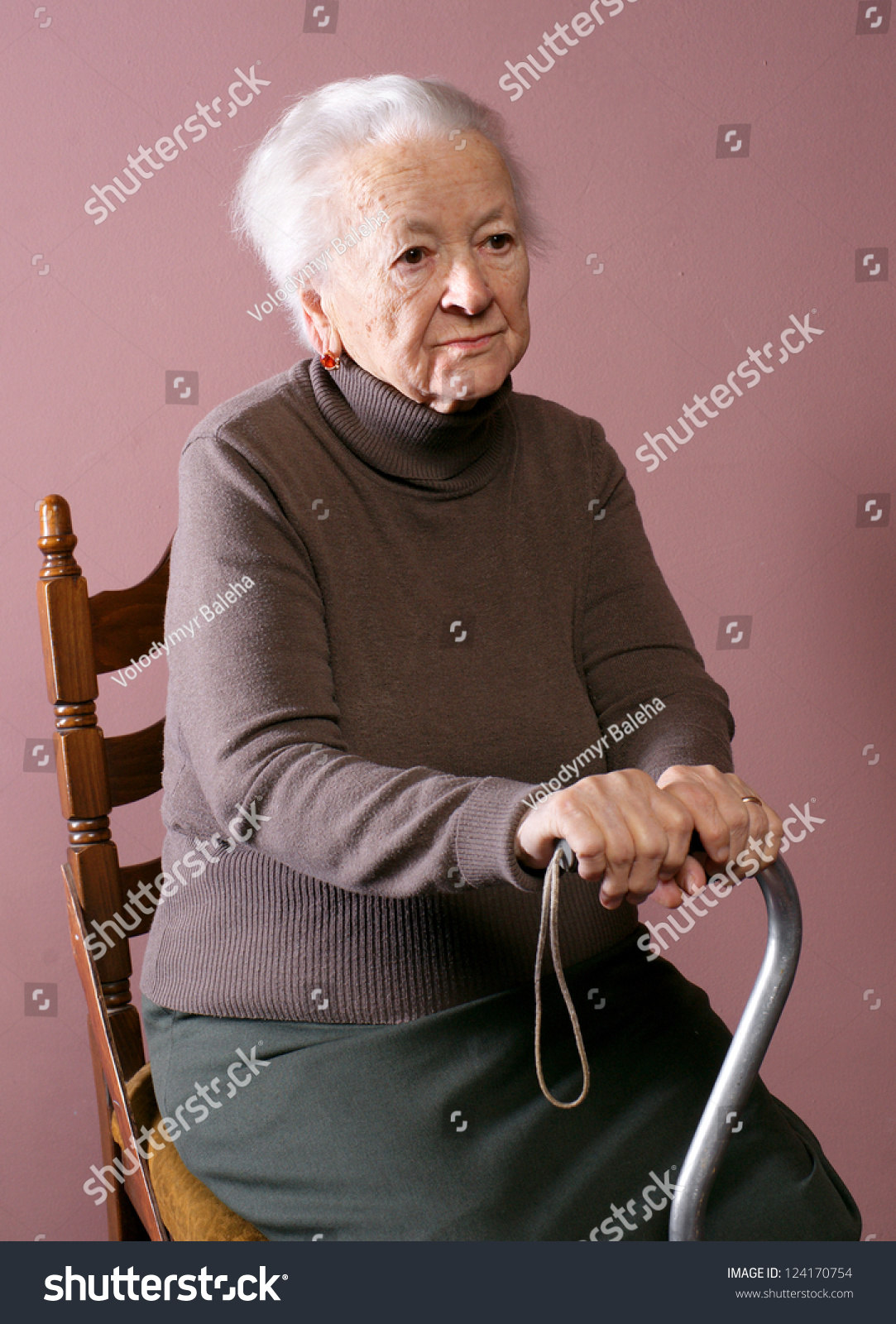 old lady chair wicker high back dining woman sitting on cane stock photo 124170754