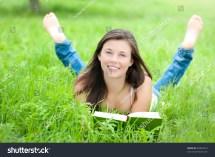Outdoor Portrait Teenager Reading Book Stock