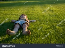 Pensive Little Boy Lying Grass Stock 495322753