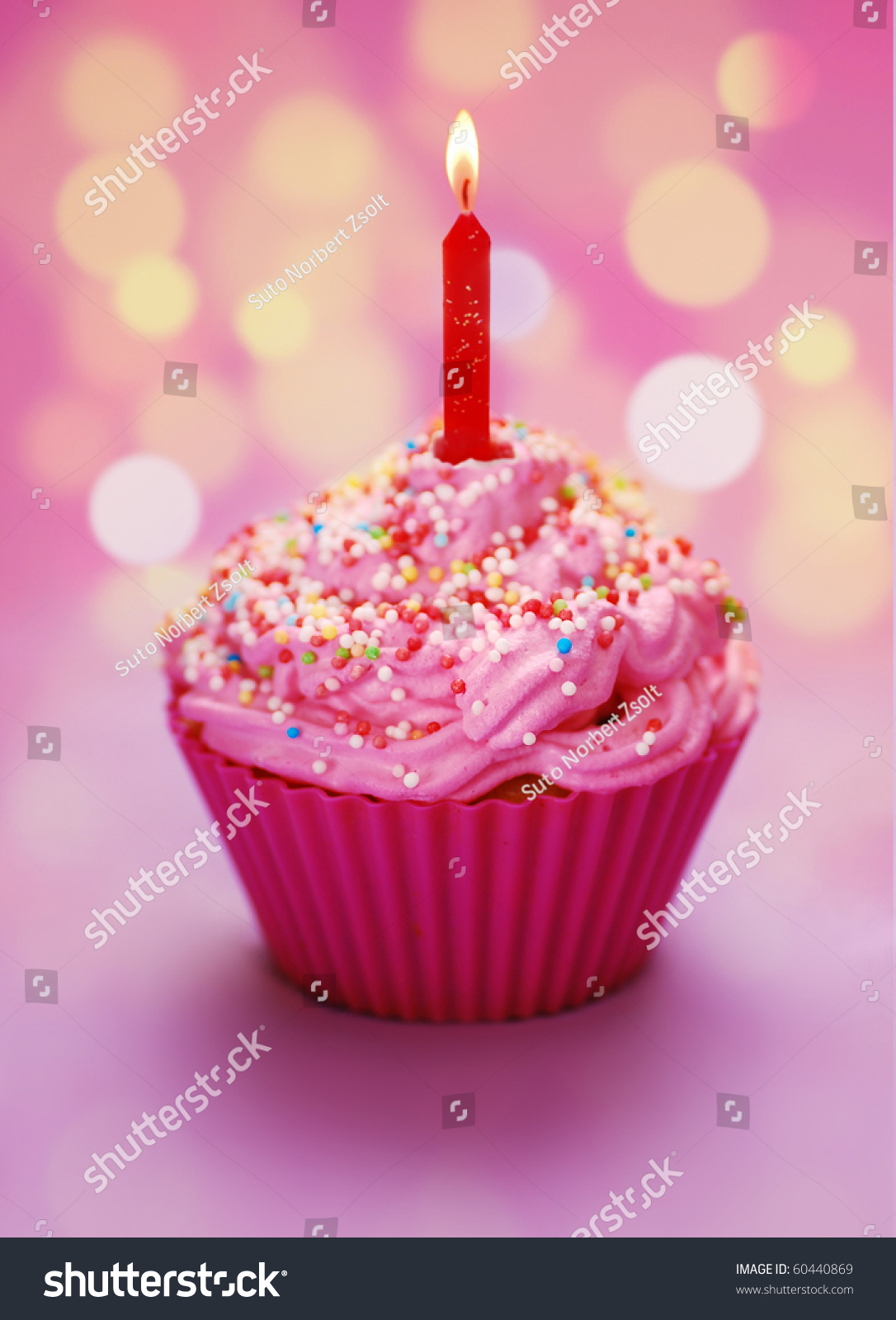 Pink Birthday Cupcake With A Candle Stock Photo