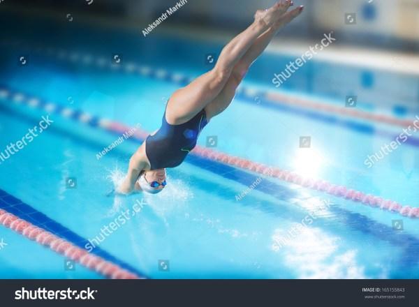 Portrait Female Swimmer Jumping Diving Stock