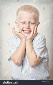 portrait happy little boy blue