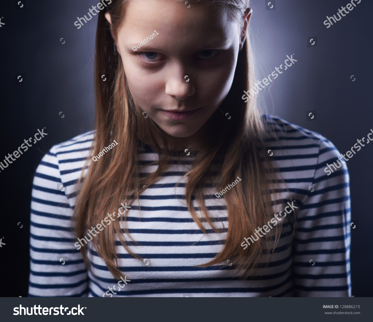 Portrait Of A Little Girl With Evil Face Stock Photo 128886215 : Shutterstock