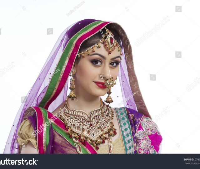 Portrait Of Beautiful Indian Bride Against White Background