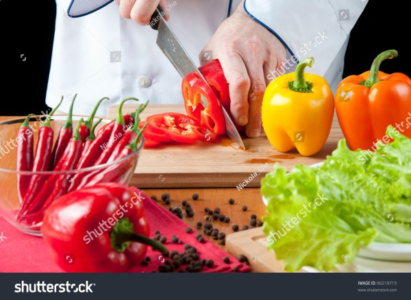 Preparing Food Chef Cutting A Red Bell Pepper Stock Photo