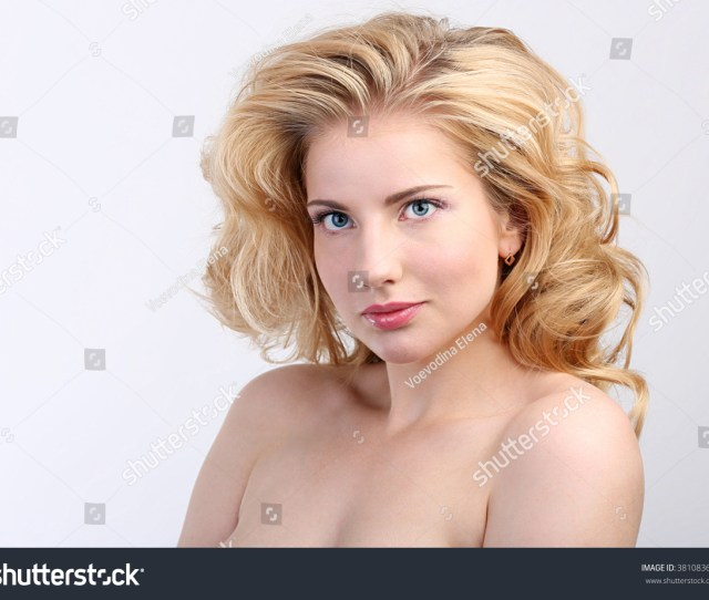 Pretty Girl With Big Eyes With Naked Shoulders A Model With Light Nude Make