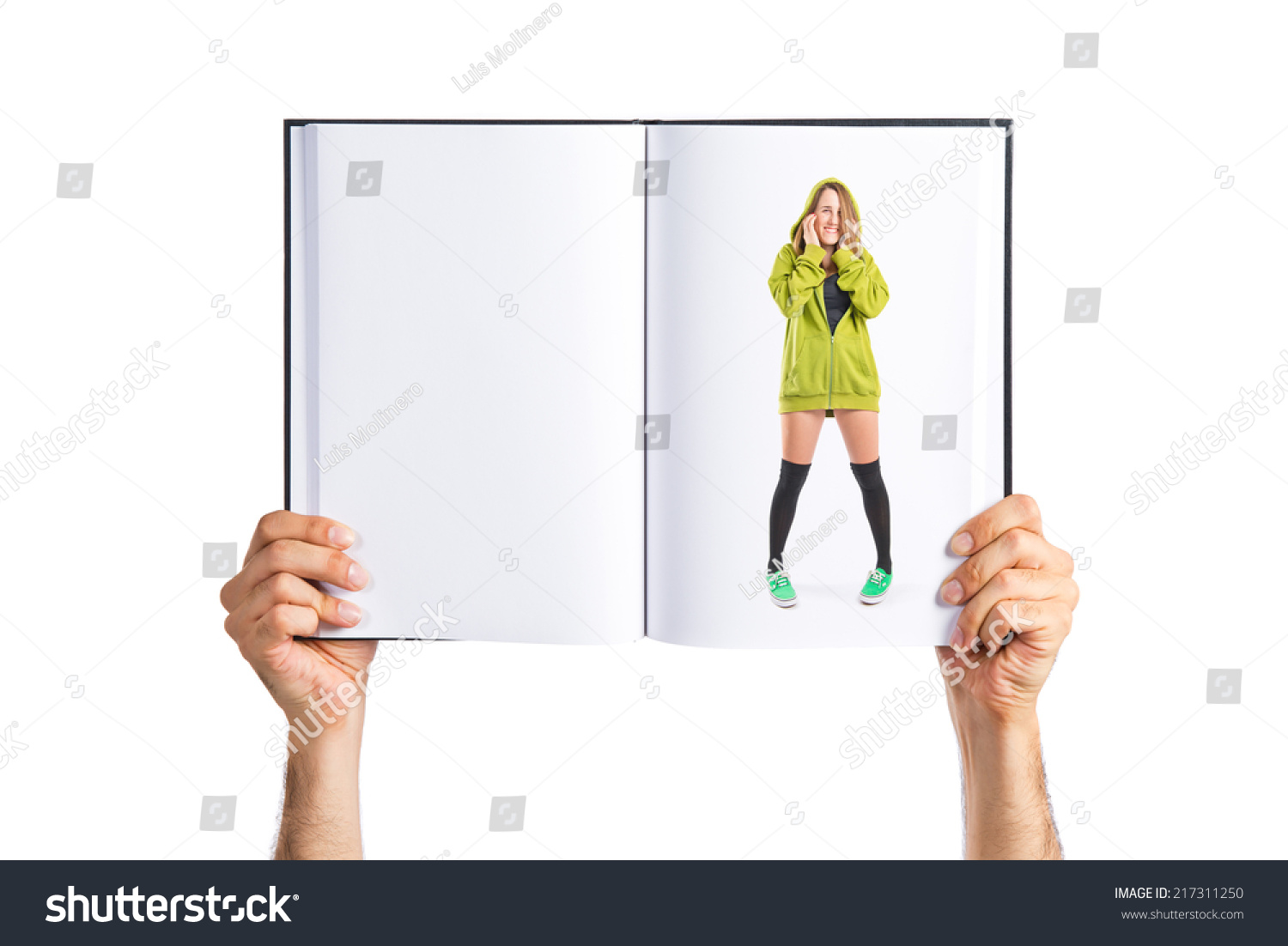 hight resolution of pretty young girl covering her ears printed on book