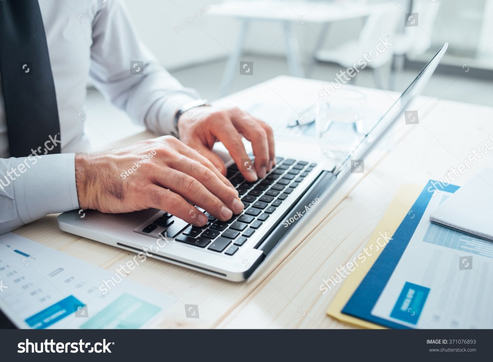 medium resolution of professional businessman working office desk typing stock