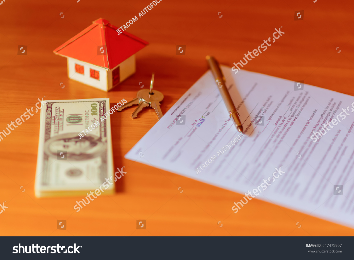 Real Estate Broker Sale Contract For House Resale Agreement With Ink Pen  And House Keys On