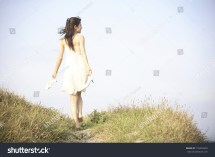 Rear View Japanese Woman Walking Barefoot Stock