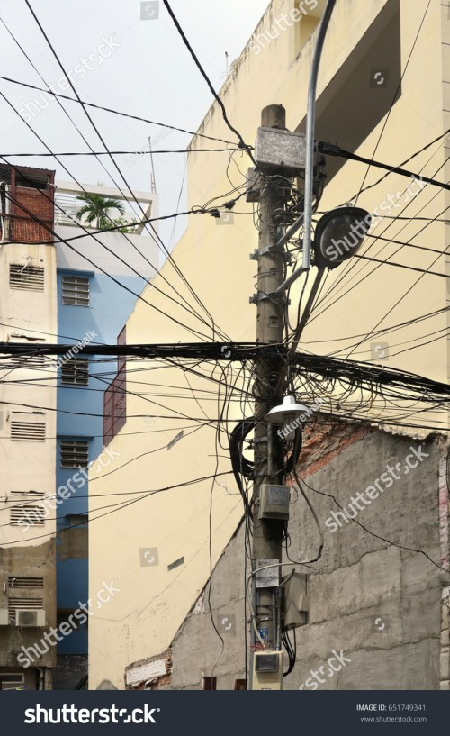 small resolution of residential power supply tangled wires on a telephone pole for supplying neighboring apartment buildings with electricity in downtown saigon vietnam