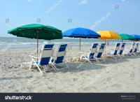 Row Of Beach Chairs And Umbrellas On The Beach Stock Photo ...