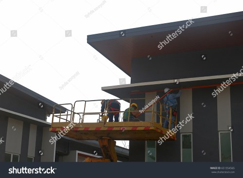 small resolution of march 3 2017 construction workers on crane installing electrical wiring