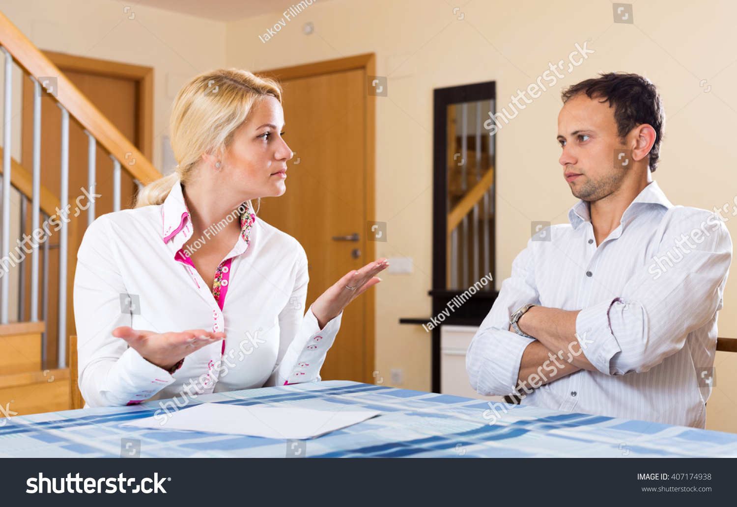 Serious Adult Couple Talking Living Room Stock Photo