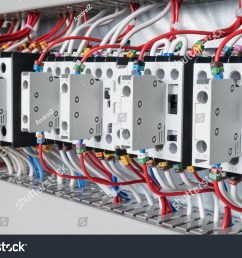 several contactors arranged in a row in an electrical closet the contactors connected wire number  [ 1500 x 1101 Pixel ]