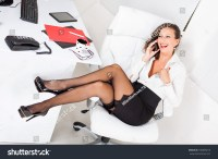 Sexy Business Woman Sitting On Office Chair And Talking On ...