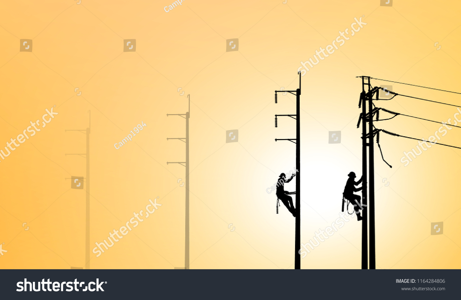 hight resolution of silhouette electrical engineers working on electricity pylon high tension power line repairs and maintenance on blurry