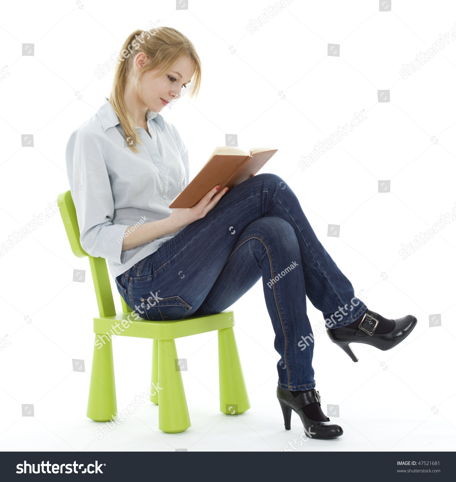woman sitting in chair target lawn chairs folding on green childs young stock photo 47521681