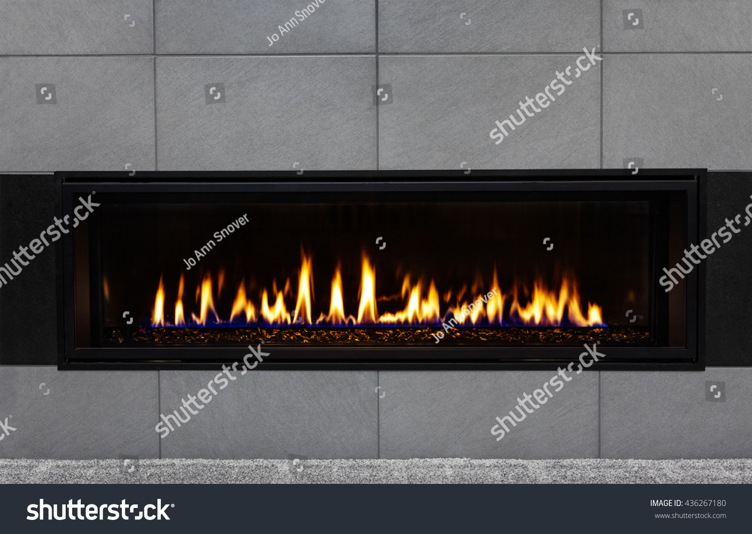Sleek Modern Gas Fireplace With Gray Tile Surround And