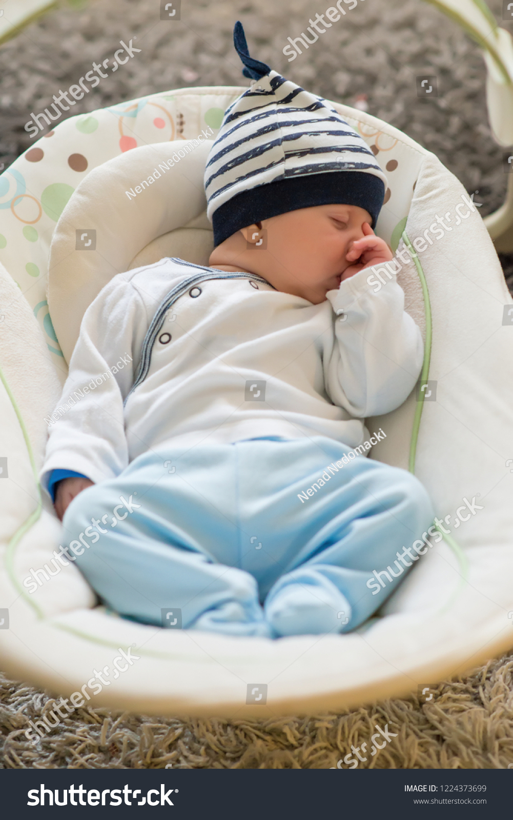 baby sleeping chair bliss hammocks zero gravity swing automatic electrical stock photo edit now in and sucking left thumb