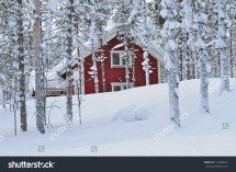 Snow-Covered Log Cabin