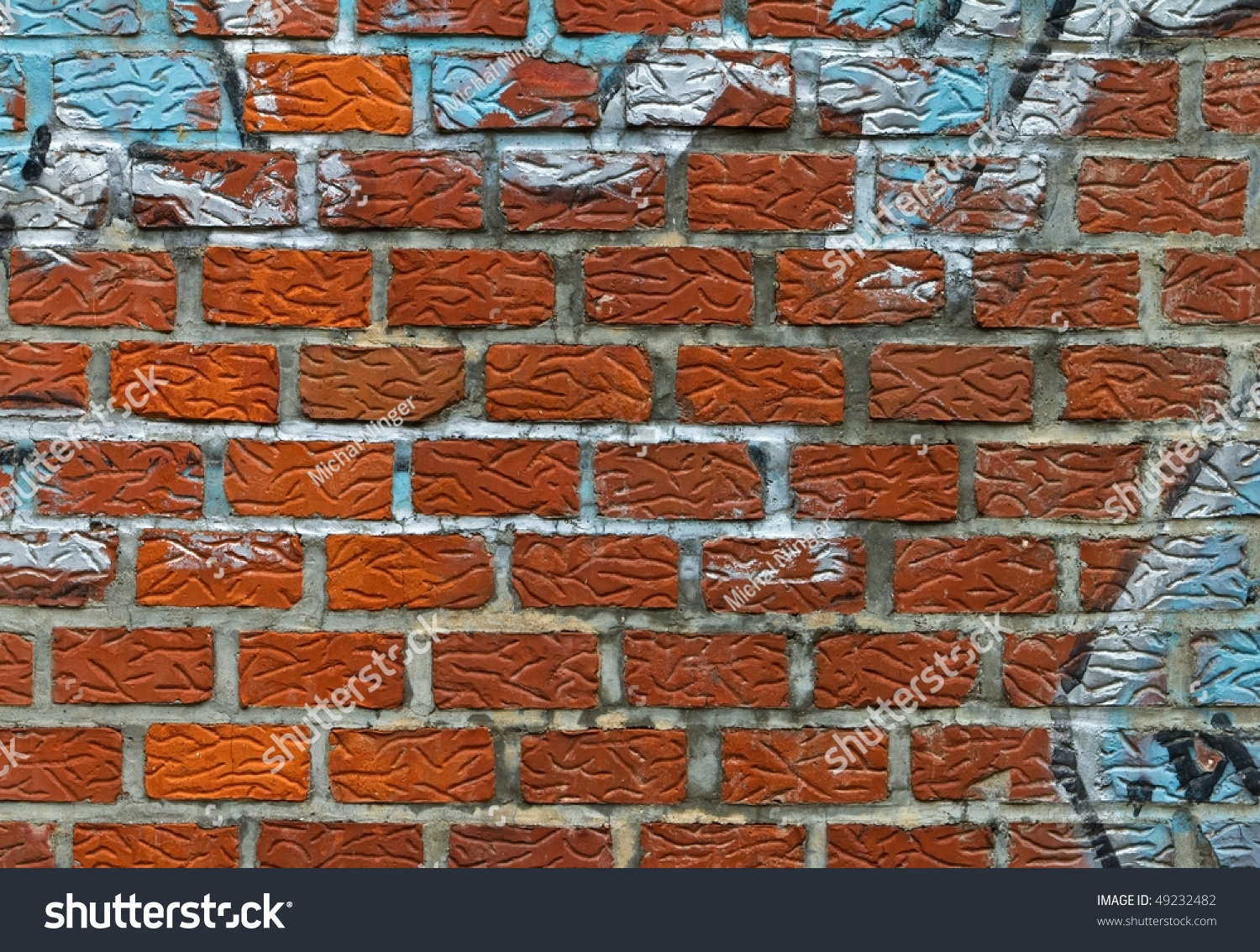How To Spray Paint A Brick Wall