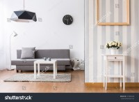 Stylish Living Room With Grey Sofa And Small Coffee Table ...