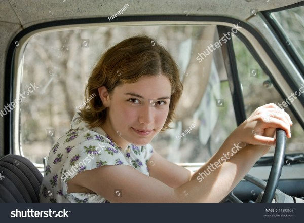 Teenage Girl Driving An Old Pickup Truck Closeup