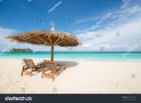 Thatch Umbrella Beach Chair On Tropical Stock Photo ...