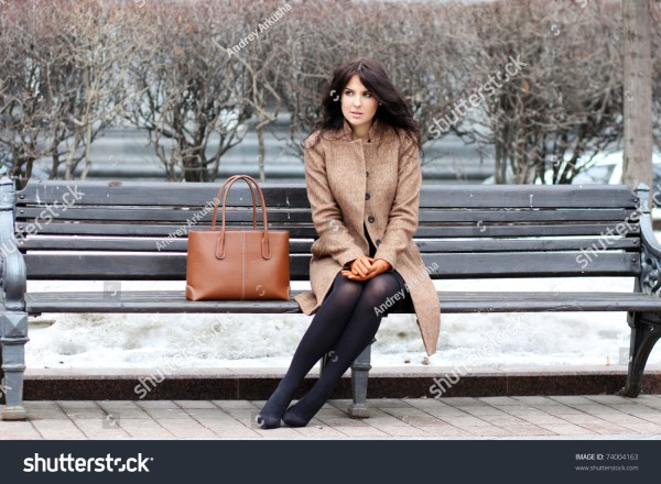 Beautiful Young City Woman Sits Bench Stock