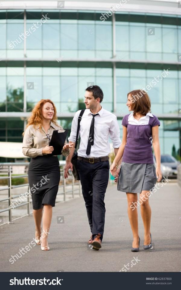 Happy Business People Walking