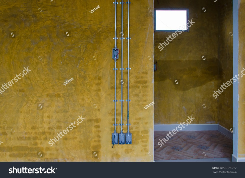 medium resolution of three steel tube wiring on yellow loft wall