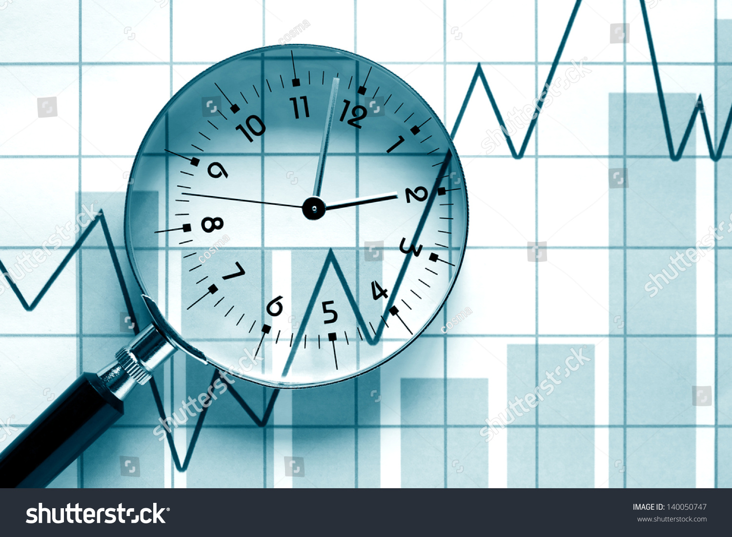 hight resolution of clock face inside magnifying glass on background with business chart