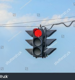 traffic light on red hanging on wires in the air [ 1500 x 1101 Pixel ]
