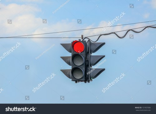 small resolution of traffic light on red hanging on wires in the air