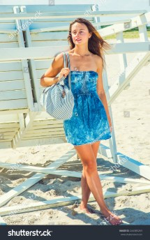 Traveler. Dressing In Strapless Denim Sun Dress Carrying
