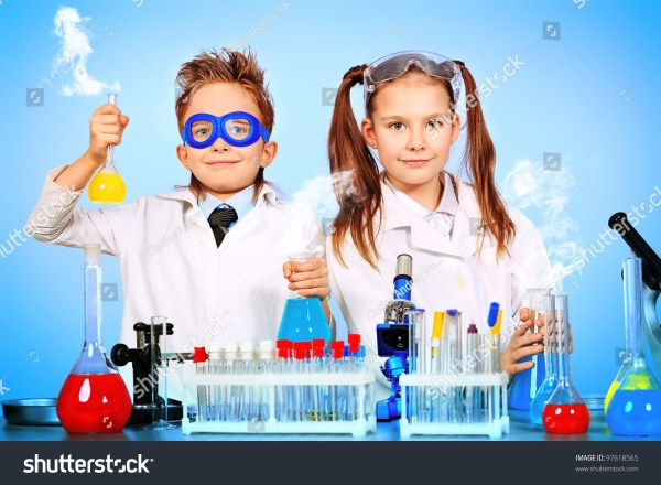 Two Children Making Science Experiments. Education. Stock