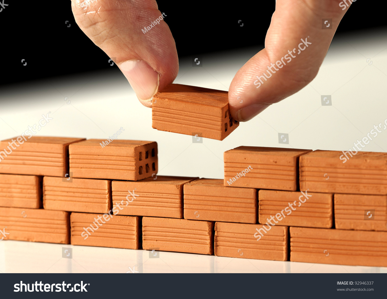 Two Fingers Put Last Brick On Stock Photo 92946337
