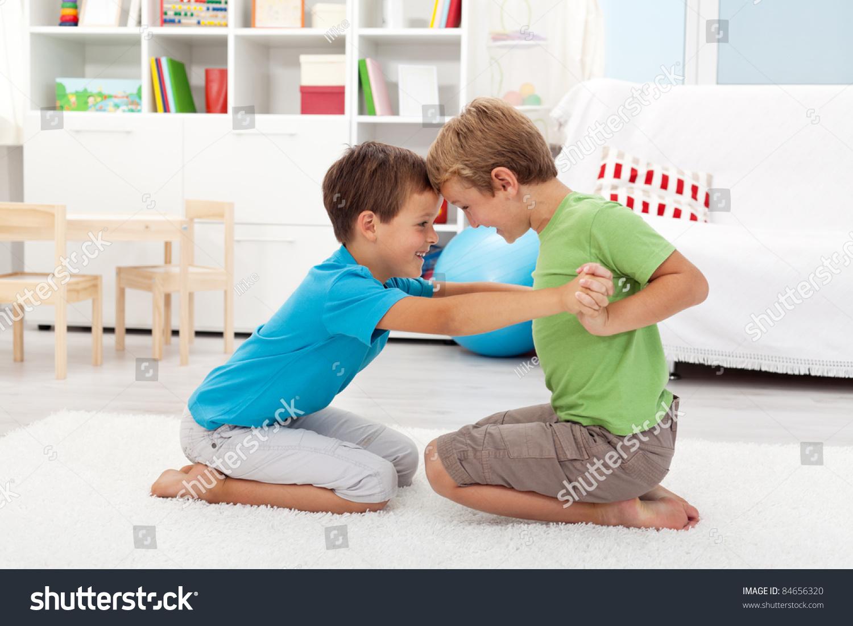 Two Happy Boys Wrestling Kids Room Stock Photo