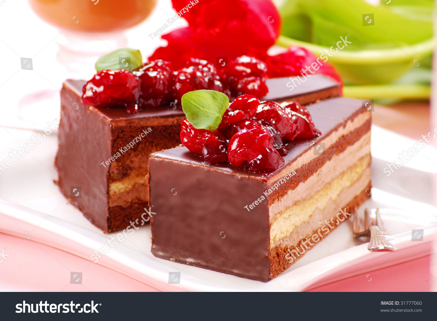 Two Pieces Of Chocolate Cake With Cherry Stock Photo