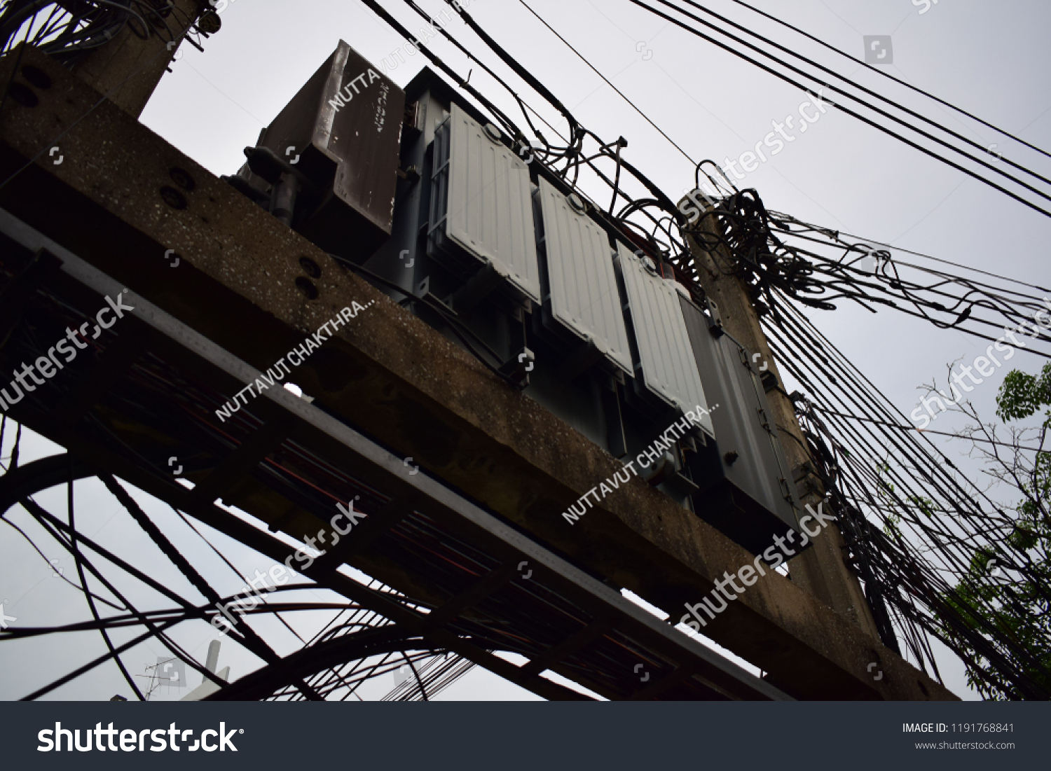 hight resolution of under shot of old steel electricity transformer that was put on conrete structure among distribution of