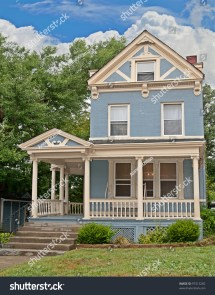 Victorian Style Brick Home Painted Blue With Cream Trim