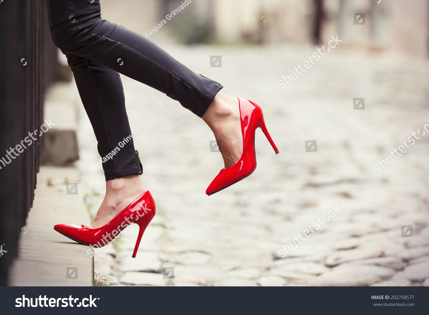 high heel shoe chair value city hydro water ski woman wearing black leather pants and red shoes