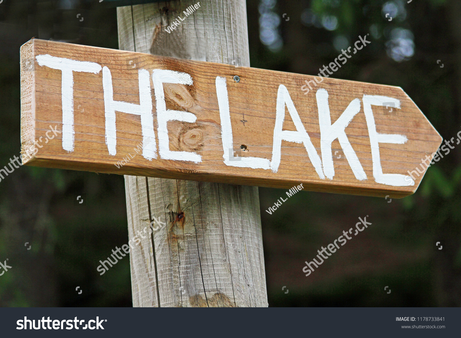 wooden directional sign that
