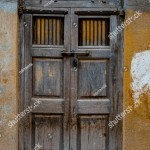Wooden Door Artistic Carved Designs Above Royalty Free