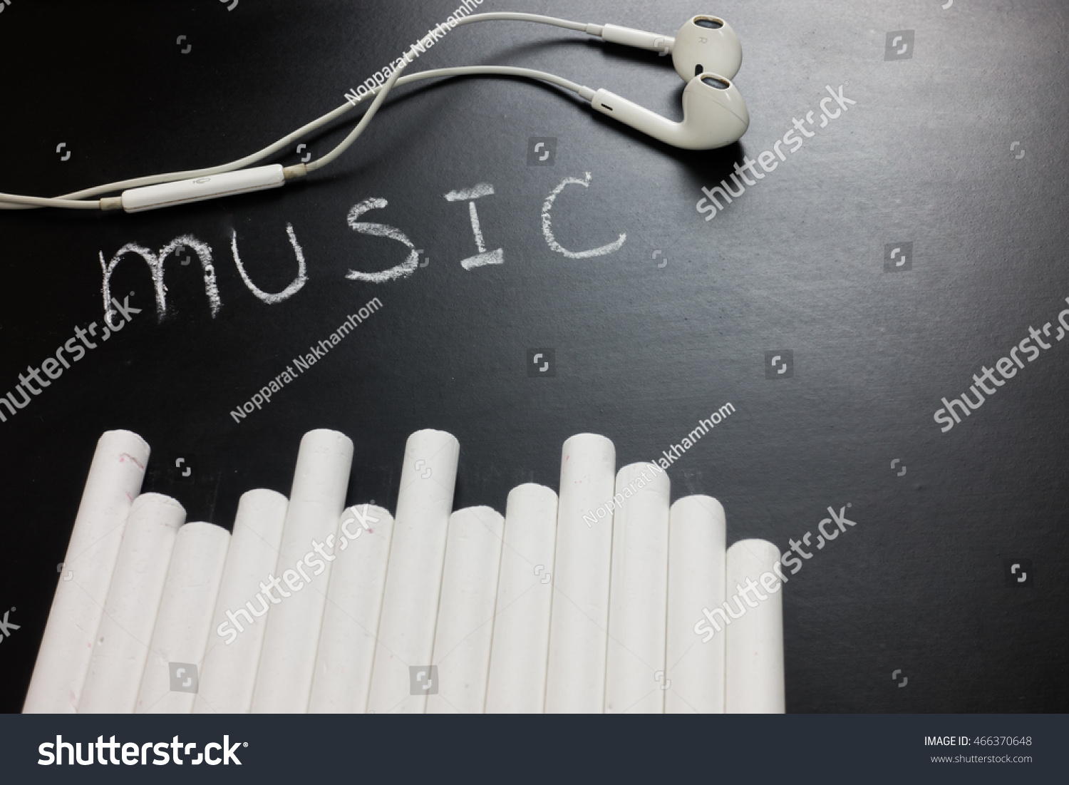 hight resolution of word music with chalk and ear pod on black board for music teaching concept