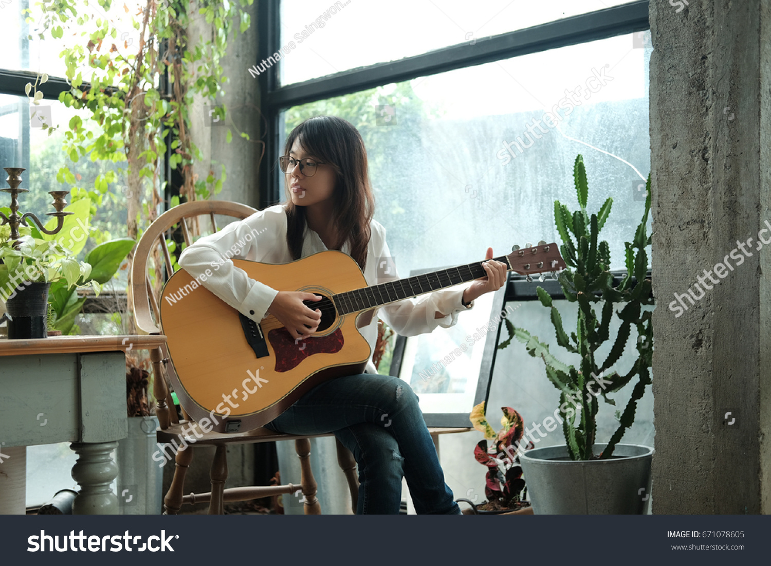 guitar playing chair time out with straps young asia woman using classic stock photo