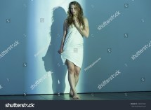 Young Battered Woman Standing Barefoot Stock